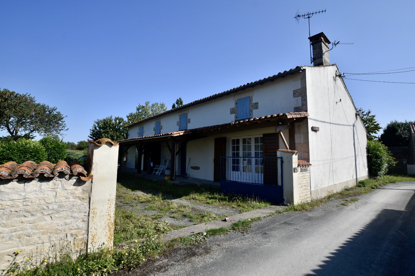 Village longère with outbuildings and lots of potential