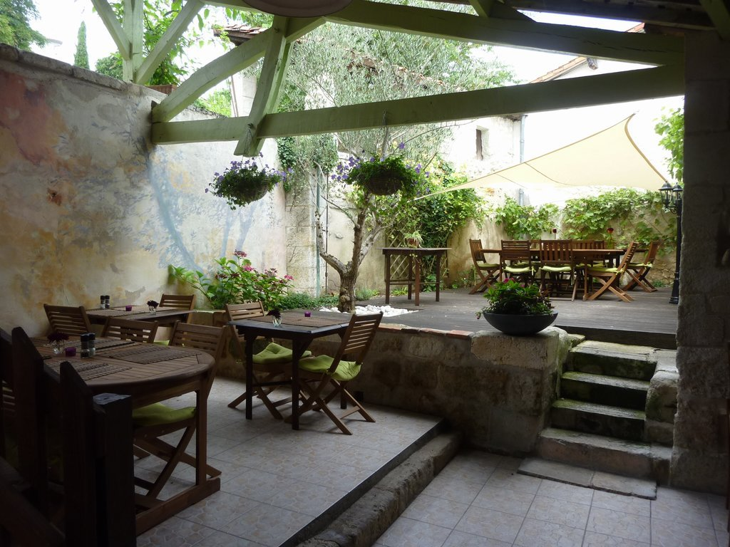 4 apartments in a former 11th century pilgrim hospital with restaurant