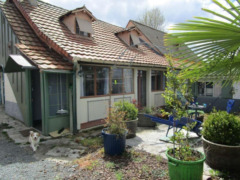Property with outbuilding and garage