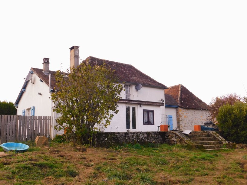 Detached stone house with garage and lots of land