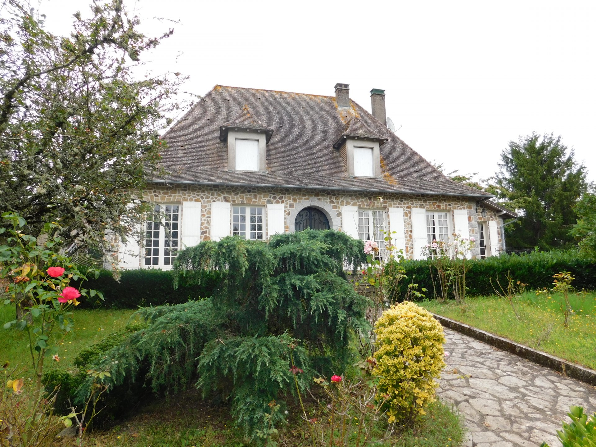 Traditional style detached house in lively village